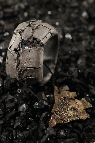 Shop Emerging Conscious Agender Avant-garde Brand Nomad Goba X Ossa Jewelry Collaboration Hand Carved Silver Cracked Ring at Erebus