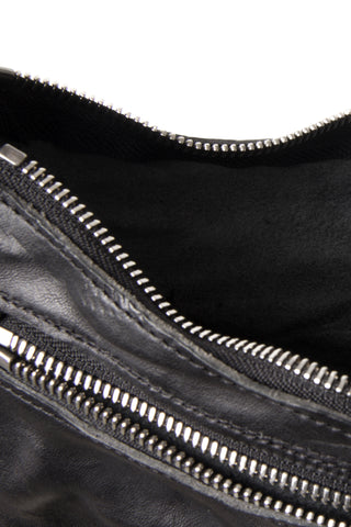 Shop Emerging Slow Fashion Avant-garde Artisan Leather Brand Gegenüber Black Hang 5 Hobo Bag at Erebus