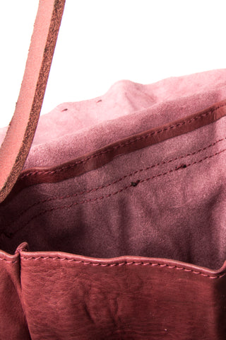 Shop Emerging Slow Fashion Avant-garde Artisan Leather Brand Gegenüber Red Mond Half Moon Bag at Erebus