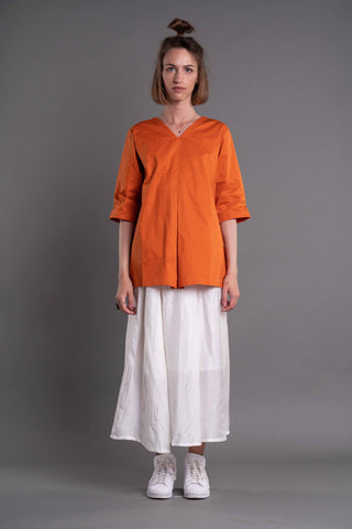 Shop Emerging Dark Conceptual Brand Anagenesis Albedo Collection Orange V Top at Erebus