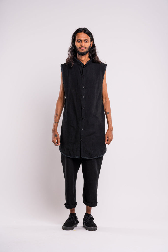 Shop emerging dark conscious fashion genderless brand Anoir by Amal Kiran Jana Black Raw Sleeveless Shirt at Erebus