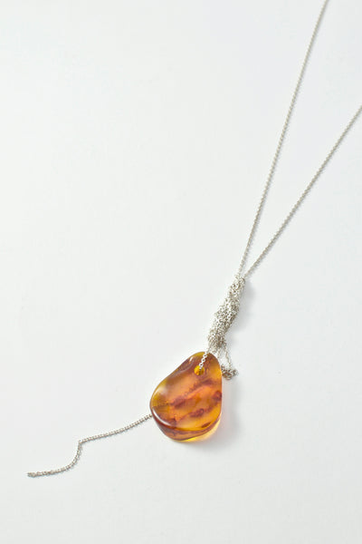Shop Emerging Conscious Avant-garde Brand Black Rock Jewel Orange Baltic Amber Necklace at Erebus