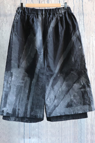 Shop Emerging Conscious Agender Avant-garde Brand Nomad Goba Hand-painted Black Linen Hakama Skirted Shorts at Erebus