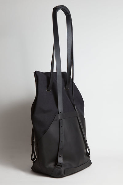 Shop Emerging Conscious Avant-garde Designer Brand MDK Miranda Kaloudis Black Leather and Waxed Cotton Canvas Transformable Kionas 8 in 1 Backpack Bag at Erebus