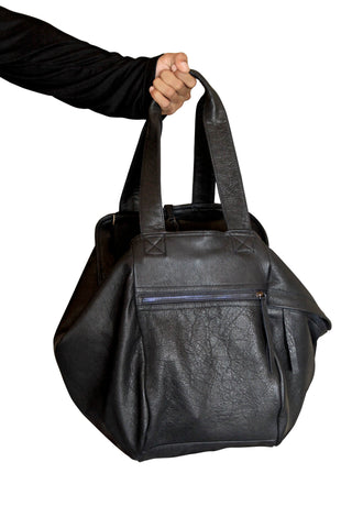 Shop Emerging Slow Fashion Genderless Avant-garde Designer Mark Baigent Reclaimed Leather Kugel Bag at Erebus