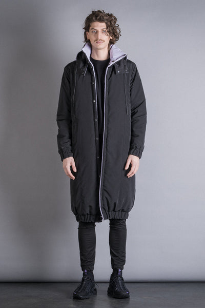 Shop Conscious Contemporary Brand Zsigmond Dora Menswear Rural Explorer AW20 Collection Thistle and Black Recycled Polyester Reversible Szenta Long Coat at Erebus