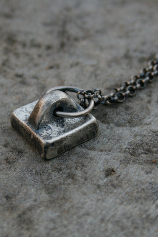 Shop Emerging Slow Fashion Avant-garde Jewellery Brand Gothmos Silver Stamp Necklace Necklace at Erebus