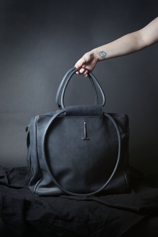 Shop Emerging Conscious Avant-garde Designer Brand MDK Miranda Kaloudis Waxed Charcoal Leather Monad Bag at Erebus