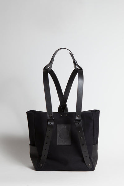 Shop Emerging Conscious Avant-garde Designer Brand MDK Miranda Kaloudis Black Leather and Waxed Cotton Canvas Transformable NEO Backpack at Erebus