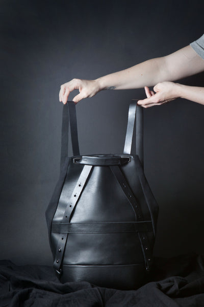 Shop Emerging Conscious Avant-garde Designer Brand MDK Miranda Kaloudis Black Leather and Waxed Cotton Canvas Transformable Pan 6 in 1 Bag at Erebus
