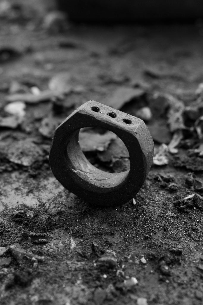 Shop Emerging Avant Garde Jewellery Brand Surface/Cast Black Concrete Subtraction Three Hole Small Ring at Erebus