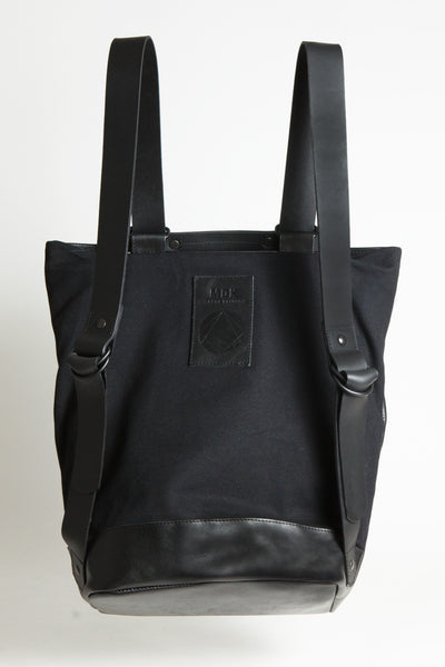 Shop Emerging Conscious Avant-garde Designer Brand MDK Miranda Kaloudis Black Box Leather Transformable Tesris Bag at Erebus