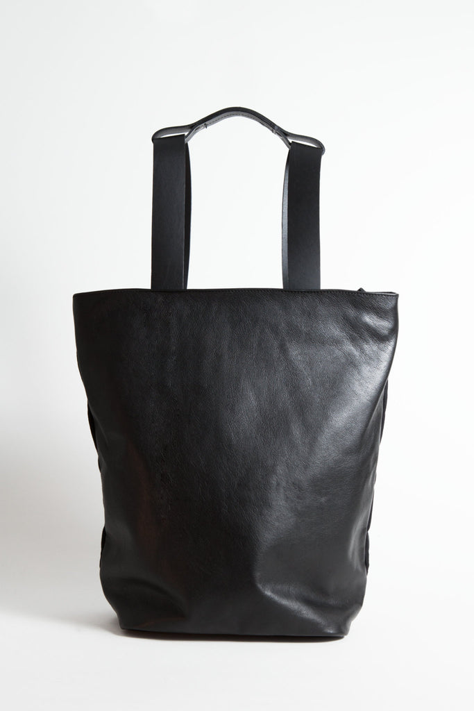 Shop Emerging Conscious Avant-garde Designer Brand MDK Miranda Kaloudis Black Nappa Leather and Waxed Cotton Canvas Transformable Tesris Backpack Bag at Erebus