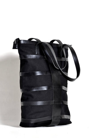 Shop emerging dark conscious fashion accessory brand Anoir by Amal Kiran Jana Black Leather and Organic Cotton Canvas Skeleton Tote Bag at Erebus