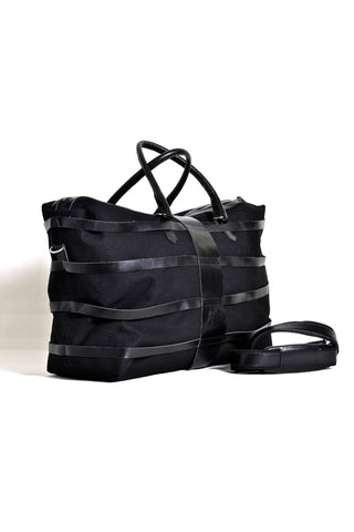 Shop emerging dark conscious fashion accessory brand Anoir by Amal Kiran Jana Black Leather and Organic Cotton Canvas Skeleton Weekender Duffle Bag at Erebus