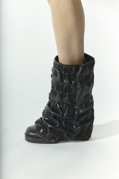 Shop Emerging Slow Fashion Avant-garde Designer Oxana Cowen Black Crinkled Leather and Wool Draped Leg Warmers at Erebus
