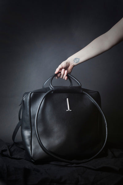 Shop Emerging Conscious Avant-garde Designer Brand MDK Miranda Kaloudis Black Leather Monad Bag at Erebus