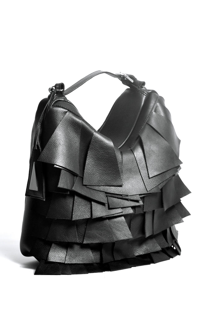 Shop Emerging Slow Fashion Accessory Brand Anoir by Amal Kiran Jana Black Leather Descending Cut Transformable Bag at Erebus