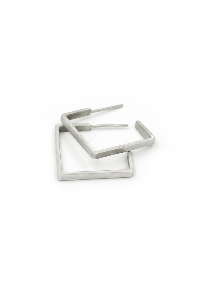 Shop Emerging Structural Jewellery Brand Conservation of Matter Silver Skinny Square Hoops at Erebus