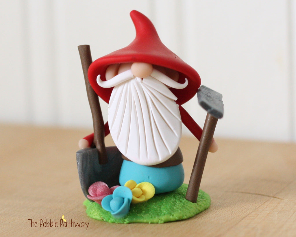 Grumpy Gardener Gnome with Rake, Shovel, Flowers 0355 - ThePebblePathway