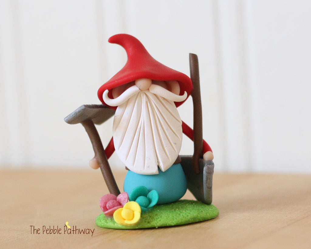 Grumpy Gardener Gnome with Rake, Shovel, Flowers 0356 - ThePebblePathway