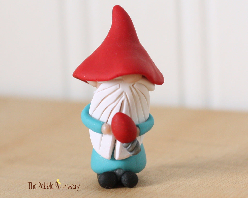 Miniature Clay Gnome holding red christmas light - Gnome ornament, Christma, Holiday decoration 0369