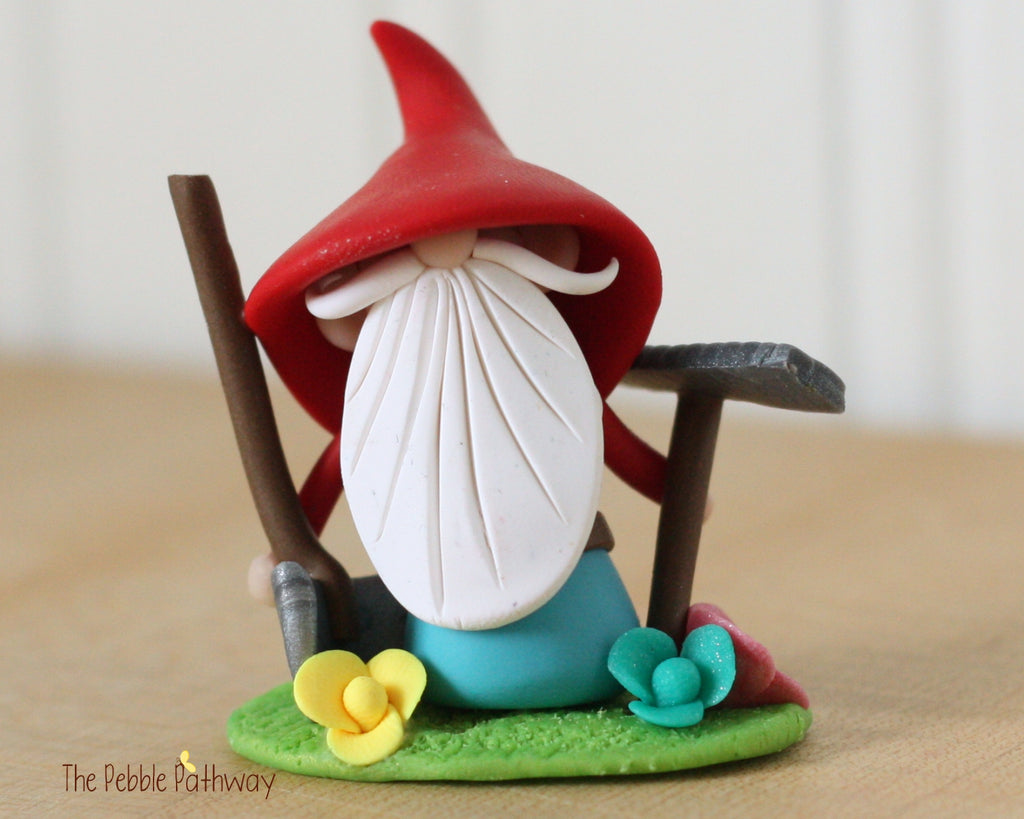 Grumpy Gardener Gnome with Rake, Shovel, Flowers 0370 - ThePebblePathway