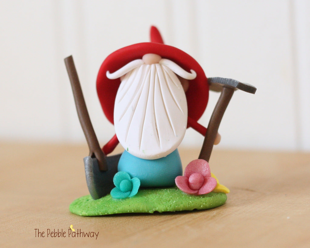 Grumpy Gardener Gnome with Rake, Shovel, Flowers 0371 - ThePebblePathway