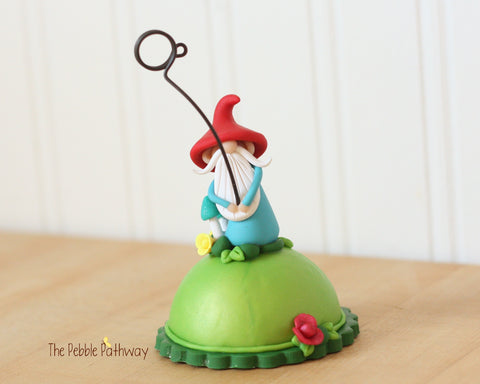 Gnome Photo Holder, Place Card Holder, Table Number Holder - Gnome with grass, flowers, mushrooms - ThePebblePathway