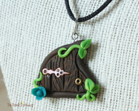 Fairy Door necklace blue flower and copper hinge - ThePebblePathway