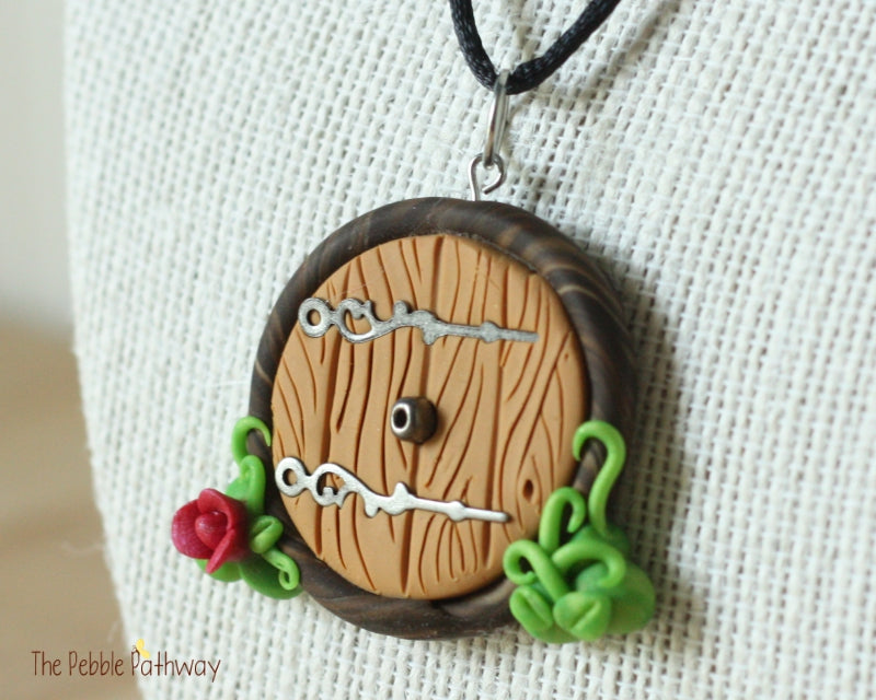 gnome home fairy door necklace with pink flower