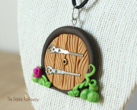 gnome home fairy door necklace with purple flower