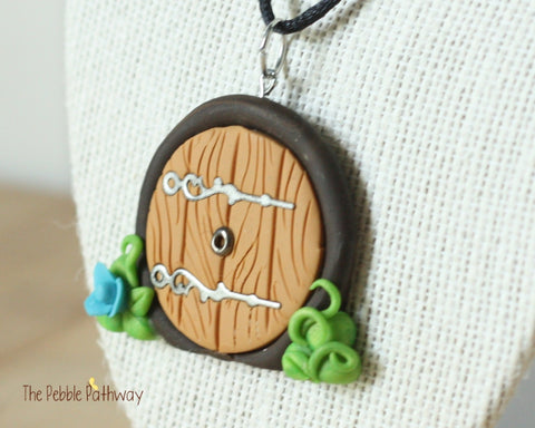 gnome home fairy door necklace with blue flower