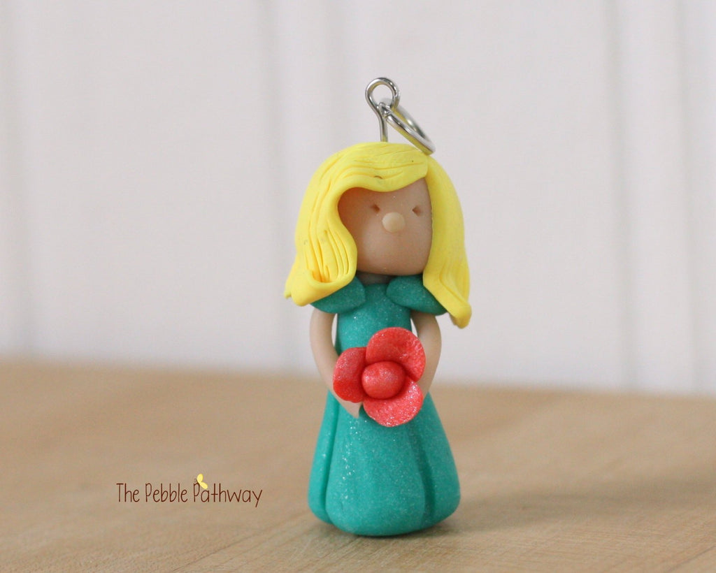 fairy ornament with short blonde hair teal dress and peach flower