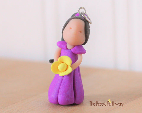 Brunette Fairy Ornament with long brown hair purple dress and yellow flower 0292 - ThePebblePathway