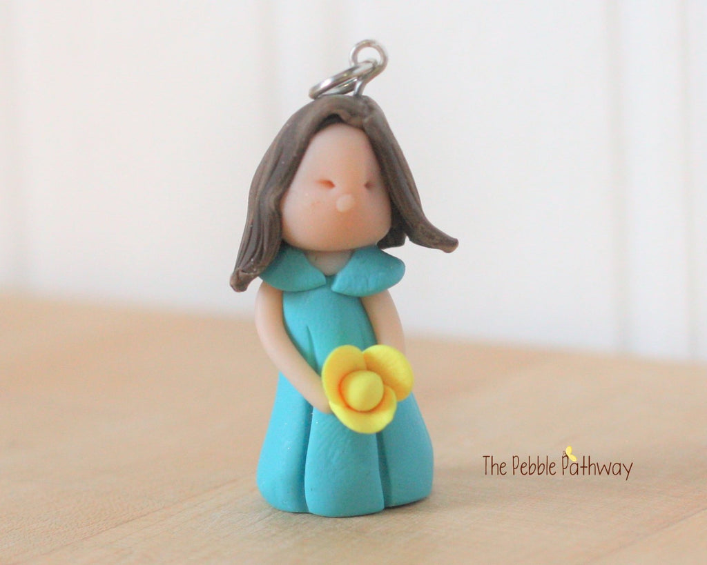 brunette fairy ornament with short brown hair blue dress and yellow flower 0293