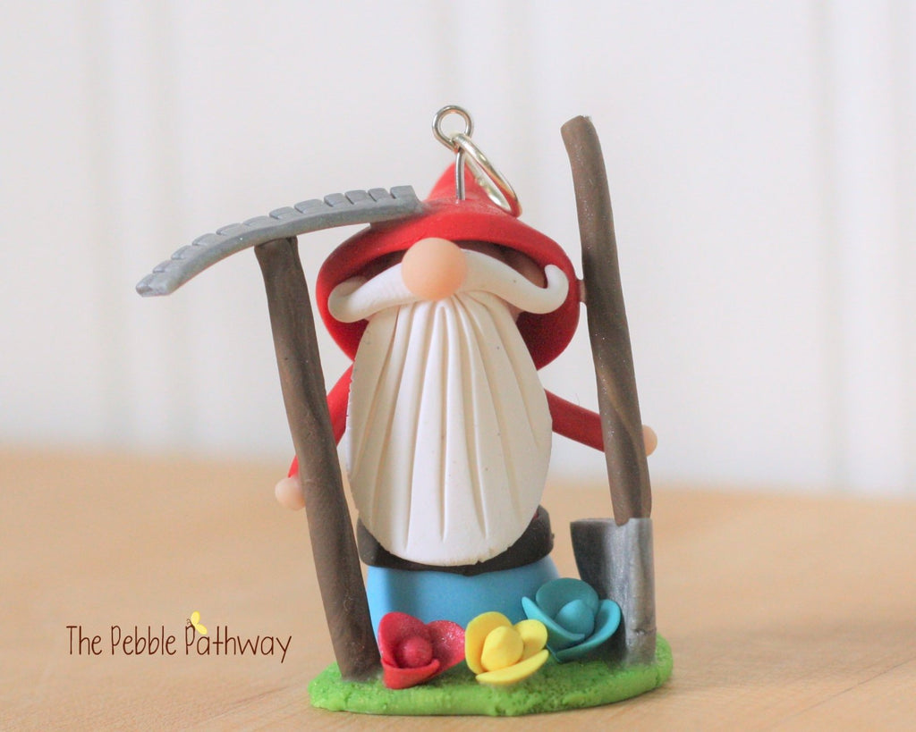 Grumpy Gardener Gnome with Rake, Shovel, Flowers 0234 - ThePebblePathway