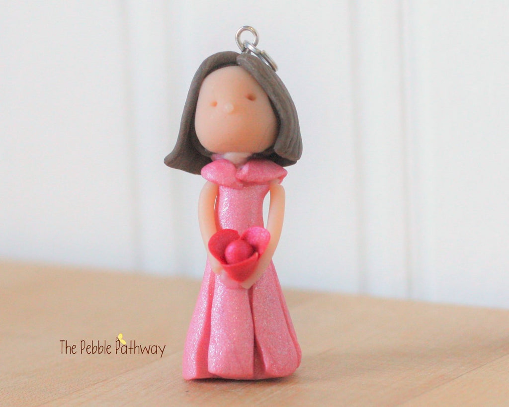 brunette fairy ornament with short brown hair pink dress and pink flower 0289