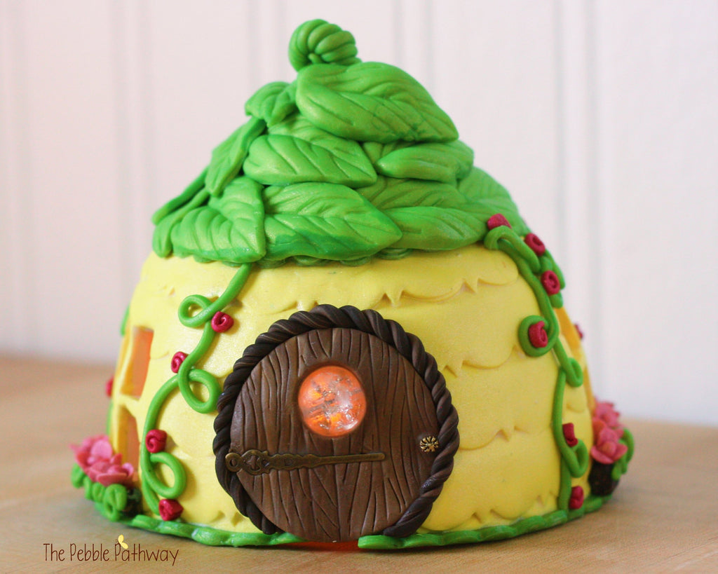 yellow fairy house with green leaf roof tea light pink flowers vines fairy door with window 0241