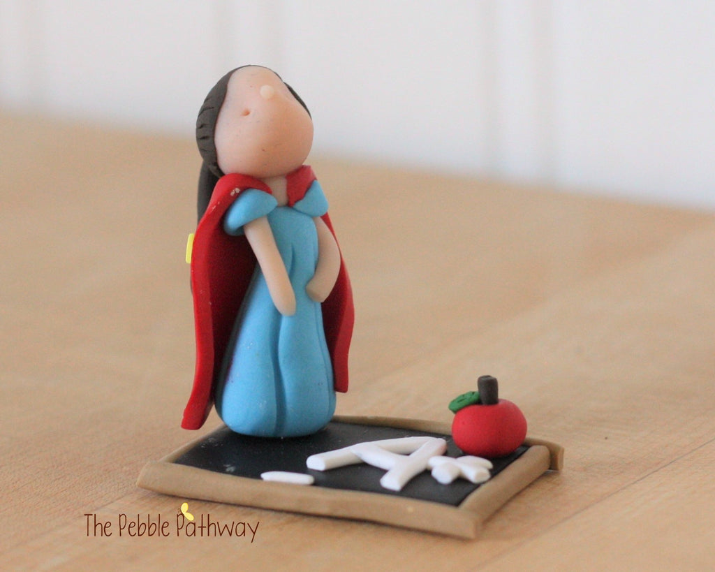 brown hair teacher hero fairy figurine on faux chalkboard with cape and apple 0238