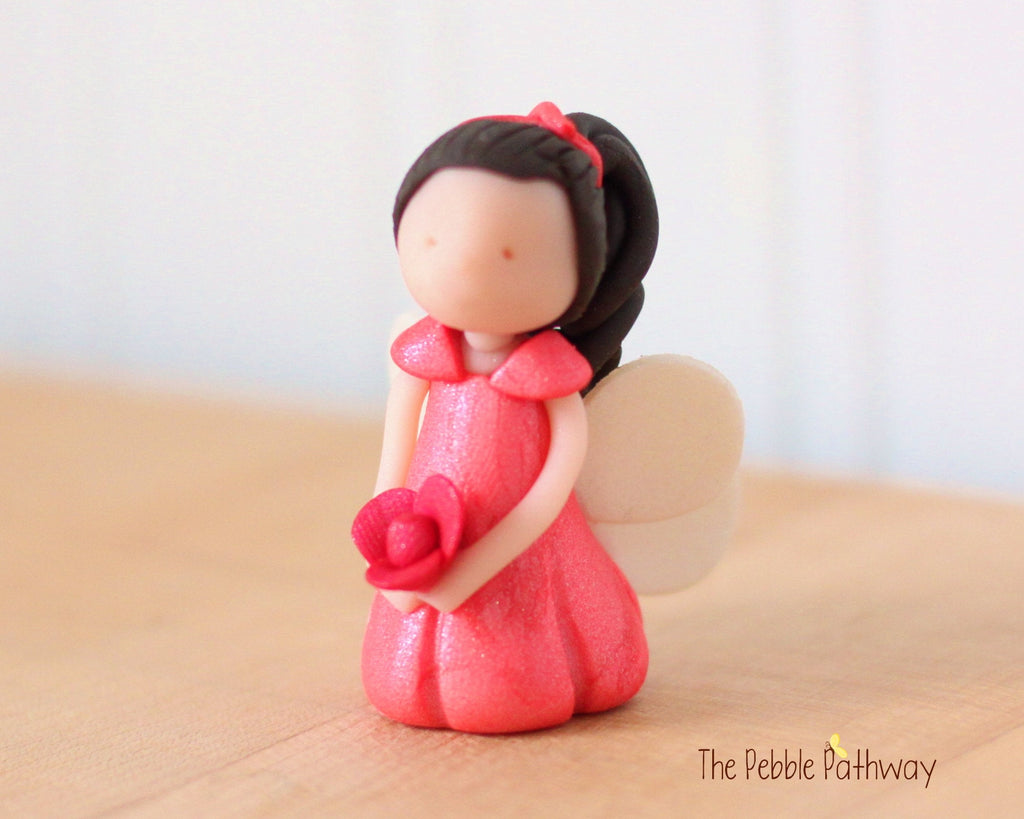 Analia the Miniature Winged Fairy with long brown hair and peach dress holding pink flower - ThePebblePathway