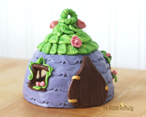 handmade-fairy-house-purple-with-green-leaf-roof-and-pink-flower-accents