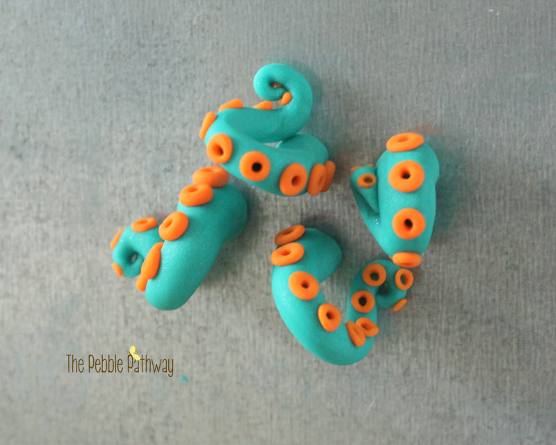 Set of 4 tentacle magnets - blue with orange suckers 001
