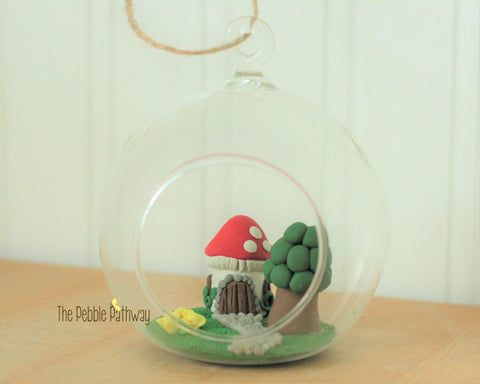 fairy garden in a glass terrarium mushroom house with windows yellow flowers fairy garden gnome home minature garden