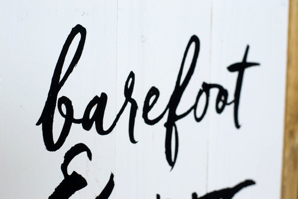 Barefoot & Free wood sign close up
