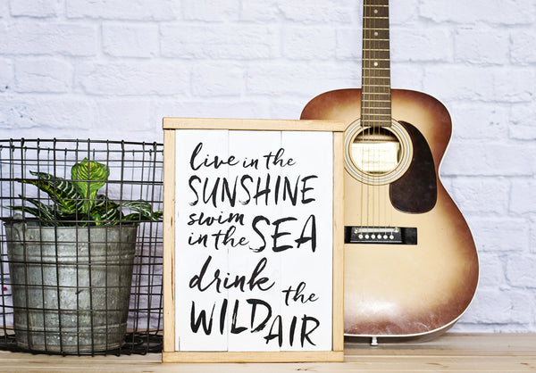 Live In The Sunshine Wood Sign styled with guitar