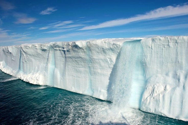 Melting ice waterfall in Svalbard, Norway