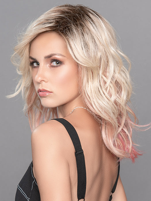 TABU by ELLEN WILLE in ROSE BLONDE ROOTED | Medium Dark Brown Roots that melt into a Pale Golden Blonde with a Mixture of Pink Tones Underneath with Darker Roots