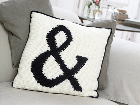 Applique ampersand crocheted cushion