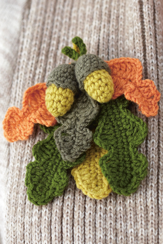 Crocheted acorn and oak leaf corsage with autumn colours